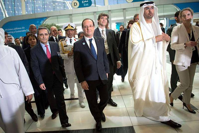 France's President Francois Hollande (C) walks with Sultan Ahmed al-Jaber (C-R), chief executive officer of the Abu Dhabi Future Energy Company (MASDAR) and French Ecology Minister, Delphine Batho (R), during a tour of the opening ceremony of the World Future Energy Summit (WFES) at the Abu Dhabi National Exhibitions Centre (ADNEC) in the Emirati capital on January 15, 2013. AFP PHOTO/BERTRAND LANGLOIS