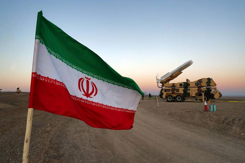 FILE PHOTO: An Iranian flag is pictured near in a missile during a military drill, with the participation of Iran's Air Defense units, Iran October 19, 2020. Picture taken October 19, 2020. WANA (West Asia News Agency) via REUTERS/File Photo