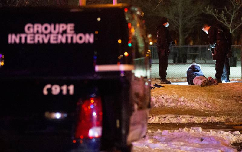 Police detain a protester as they enforce a night curfew imposed by the Quebec government to help slow the spread of the coronavirus disease (COVID-19) pandemic in Montreal, Quebec, Canada January 9, 2021.  REUTERS/Christinne Muschi