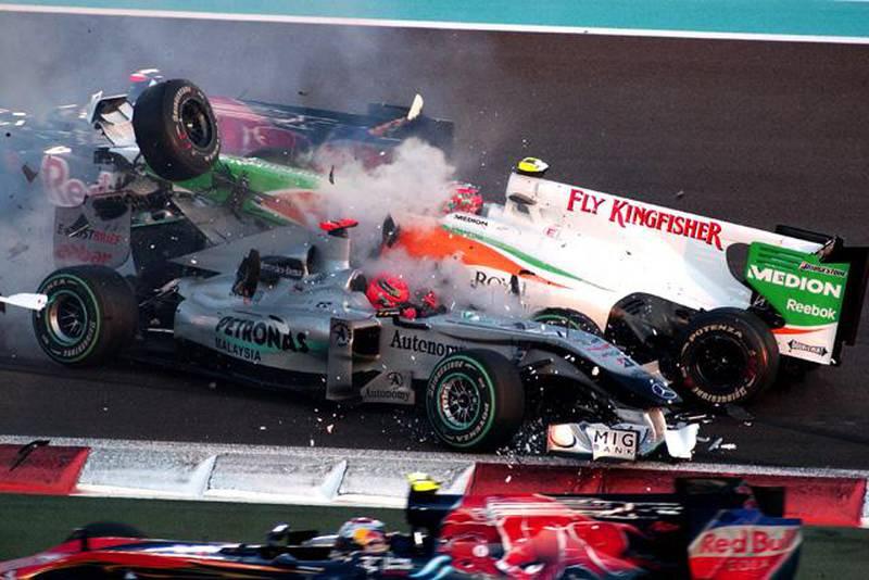 Michael Schumacher (GER) Mercedes GP MGP W01 spins and collects Vitantonio Liuzzi (ITA) Force India VJM03.Formula One World Championship, Rd 19, Abu Dhabi Grand Prix, Race, Yas Marina Circuit, Abu Dhabi, UAE, Sunday 14 November 2010. BEST IMAGE