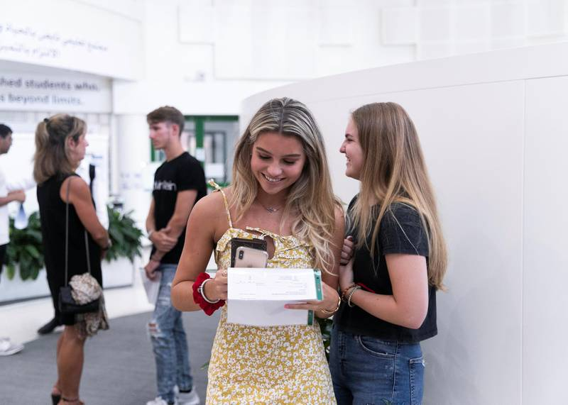 DUBAI, UNITED ARAB EMIRATES. 15 AUGUST 2019. Students receive and react to their A-Level results at Jumeirah College school.(Photo: Reem Mohammed/The National)Reporter:Section: