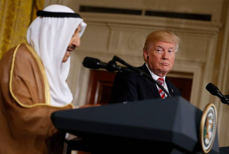 U.S. President Donald Trump (R) listens during a joint news conference with Emir of Kuwait Sabah Al-Ahmad Al-Jaber Al-Sabah in the East Room of the White House in Washington, U.S., September 7, 2017. REUTERS/Jonathan Ernst