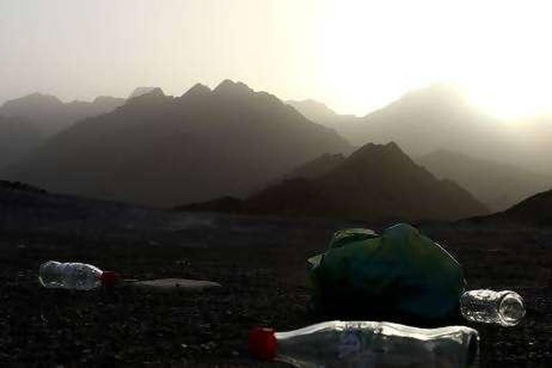 FUJAIRAH, UNITED ARAB EMIRATES- March 6: Visitors left behind their used cold drink bottles at the Wadi Wurayah in Fujairah Mountains.  (Pawan Singh / The Nation)   *** Local Caption *** na28garbage.jpg