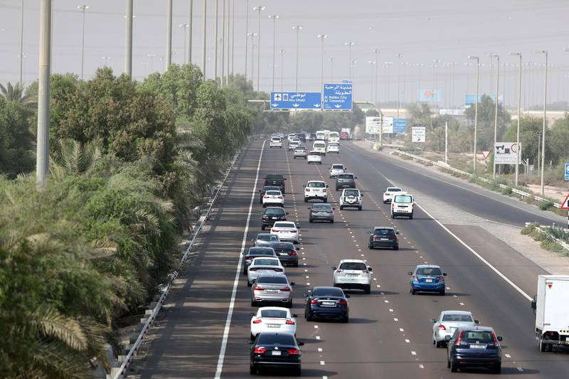 Abu Dhabi, United Arab Emirates - August 12, 2018: Morning commuters head from Dubai towards Abu Dhabi on the first day of no speed buffer. Sunday, August 12th, 2018 on E11, Abu Dhabi. Chris Whiteoak / The National
