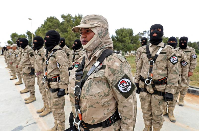 Members of Libyan special forces trained by the Turkish military, parade during a graduation ceremony in the coastal city al-Khums, about 120kms east of the capital Tripoli, on April 8, 2021.     / AFP / Mahmud TURKIA