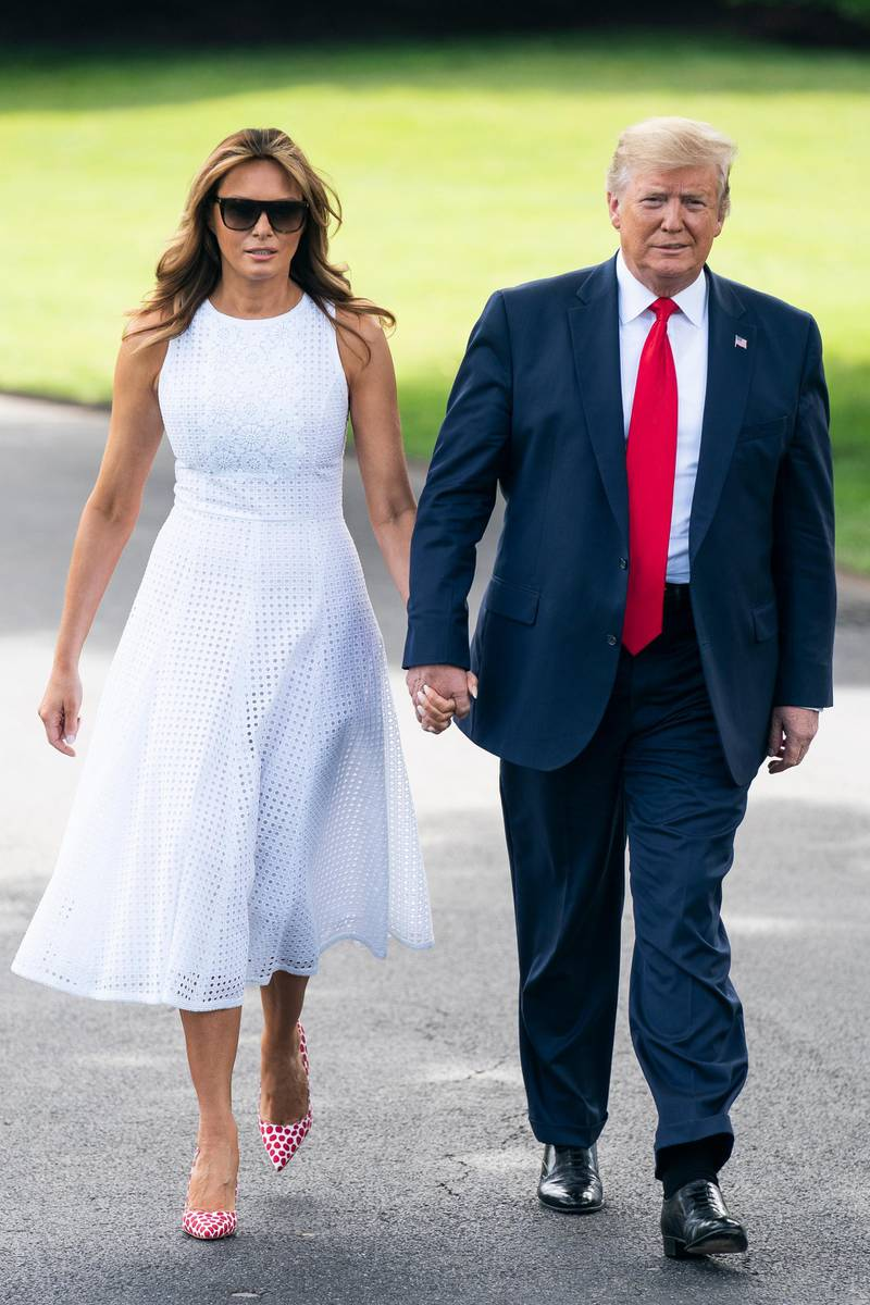 epa07656702 US President Donald J. Trump (R), alongside First Lady Melania Trump (L), prepares to speak to the media as he departs the White House for a campaign event in Florida in Washington, DC, USA, 18 June 2019. President Trump is travelling to Orlando to launch his 2020 re-election campaign. Prior to leaving the White House, the President spoke about Patrick Shanahan, who withdrew from consideration to be Trump's permanent defense secretary. He also spoke about tariffs, immigration, and growing tensions with Iran.  EPA-EFE/JIM LO SCALZO