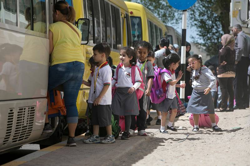 ABU DHABI, UNITED ARAB EMIRATES, Oct. 8, 2014:   Children walk from their school, the Al Worood Academy Private School, to their school buses on Wedneday, Oct.8, 2014. Police are investigating the death of 3-year-old Nizaha Aalaa, a KG-1 pupil and a first-month student at the Al Worood Academy Private School, who was found dead on a school bus shortly after noon the previous day, on Tuesday, Oct. 7, 2014, apparently left there since the morning. (Silvia Razgova / The National)  Usage: Oct. 8, 2014 Section: NA Reporter:  Lindsay Carroll