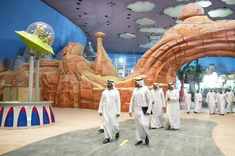YAS ISLAND, ABU DHABI, UNITED ARAB EMIRATES -  March 1, 2018: HH Sheikh Mohamed bin Zayed Al Nahyan, Crown Prince of Abu Dhabi and Deputy Supreme Commander of the UAE Armed Forces (center L), inspects construction of Warner Bros World Abu Dhabi, with and HE Mohamed Khalifa Al Mubarak Chairman of the Department of Culture and Tourism and Abu Dhabi Executive Council Member (center R).  ( Ryan Carter for the Crown Prince Court - Abu Dhabi ) ---