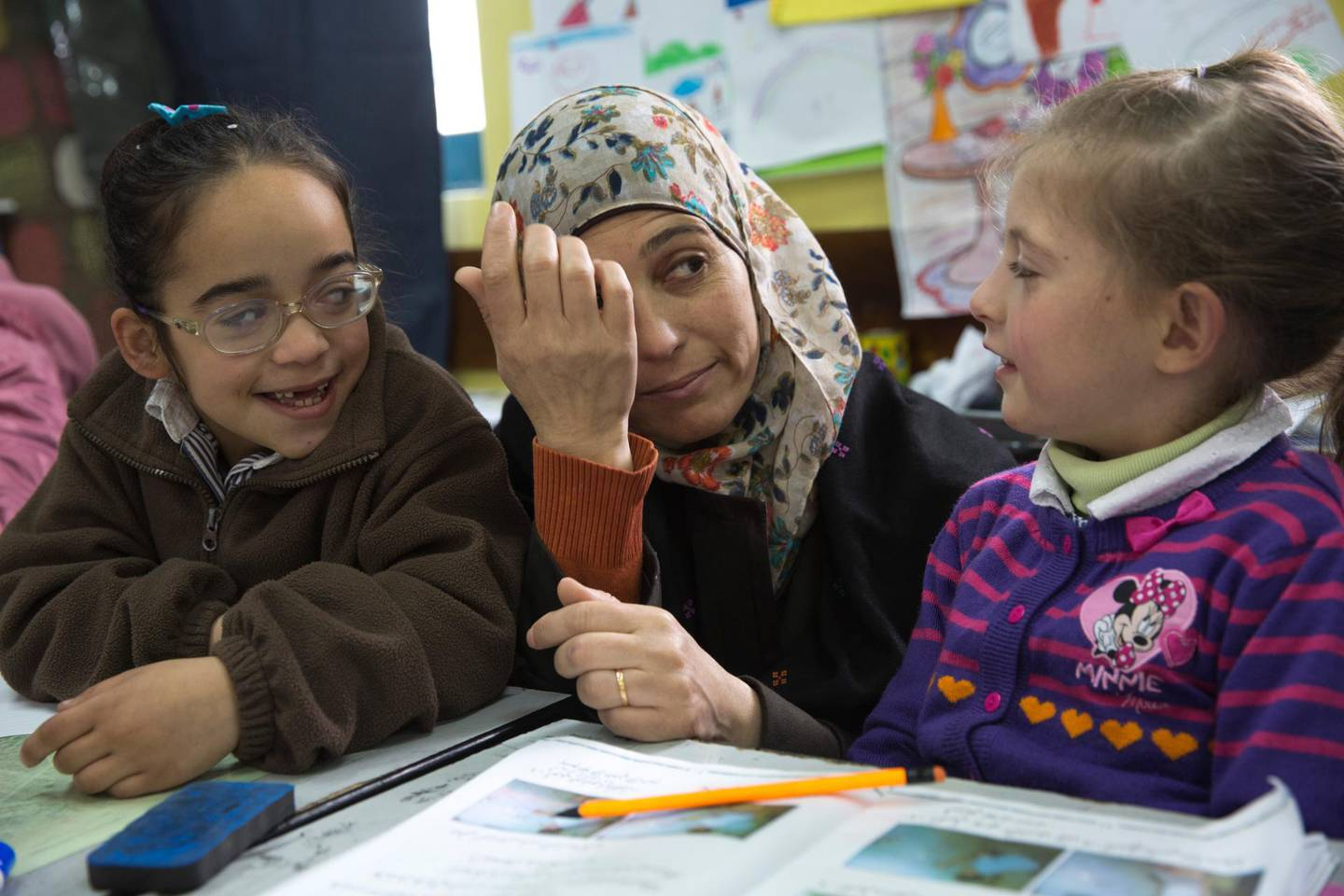"""Palestinian teacher Hanan al-Hroub as she teaches a religion class to her class of students that are 7 year-old on her first day back to teach at the  Samiha Khalil school in al-Bireh, just outside Ramallah on March 20,2016. Hanan was awarded the $1M Global Teacher Prize in Dubai. Hroub uses a technique she calls """"Play and Learn""""  she developed and  promotes no to violence .(Photo by Heidi Levine For The National). *** Local Caption ***  Levine Pal Teacher sty38.JPG"""