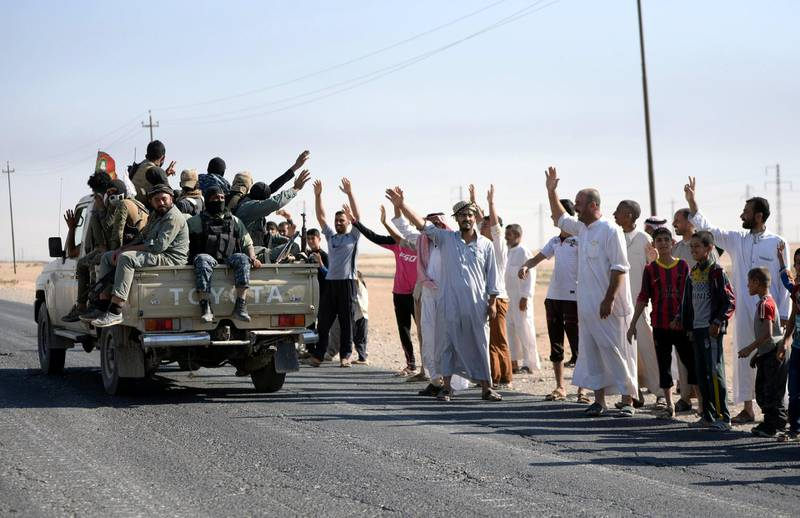 epa06269391 Kirkuk residents from the Arab population greet the members of Iraqi Shiite group which also known as Hashd al-Shaabi (The Popular Crowd) as they advance into central Kirkuk city, northern Iraq, 16 October 2017. Media reports state that the Iraqi military troops took over large areas from Kurdish Peshmerga militants without fighting, while an Iraqi military source announced that the Iraqi forces took several positions south of Kirkuk from Kurdish forces, including the North Gas Company station, a nearby processing plant and the industrial district south of the city. Thousends of Kurds families left the city due the fighting between Shiite militias and groups of Kurdish gunmen in southern the city, a local official said.  EPA/MURTAJA LATEEF