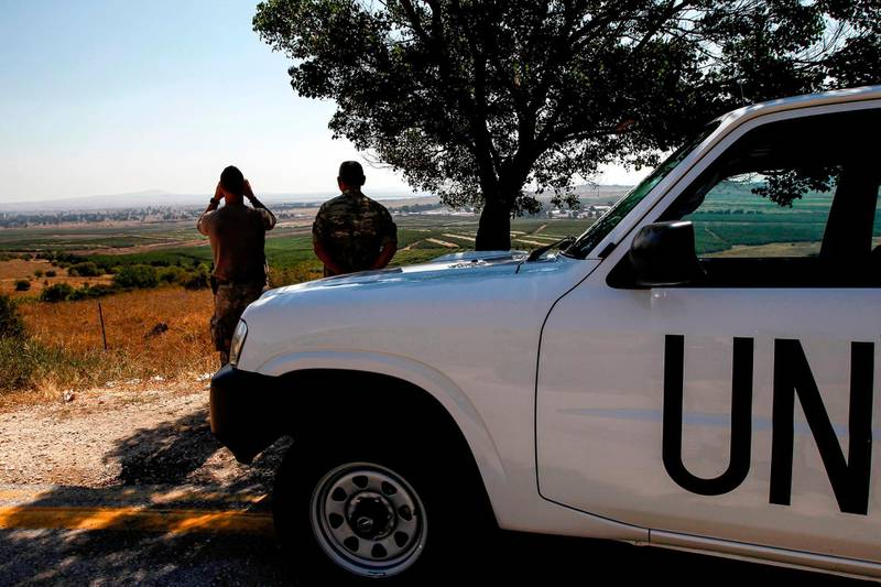 UN peacekeepers look out towards Syria from the Israeli-annexed Golan Heights on July 22, 2018.  / AFP / JALAA MAREY