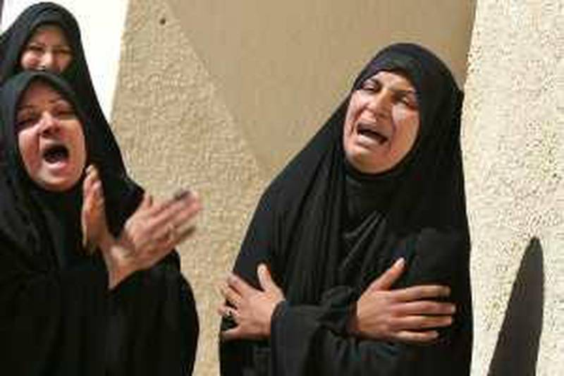 Sisters of Fayha Kadim, 23, and her son Muntadhar Waleed, 3, who were both killed in blasts in northeastern Baghdad Sunday, grieve at their funeral in Najaf, Iraq, Monday, March 8, 2010.  The election day's death toll was 36, with various incidents of rockets and mortars, hand grenades and bombs all being used to target polling stations and the people voting.  (AP Photo/Alaa al-Marjani) *** Local Caption ***  BAG113_Mideast_Iraq_.jpg *** Local Caption ***  BAG113_Mideast_Iraq_.jpg