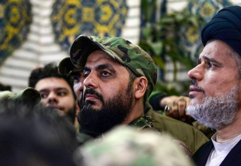 """Qais al-Khazali (C) commander of the Asaib Ahl al-Haq pro-Iran faction attends the funeral procession of slain Iraqi paramilitary chief Abu Mahdi al-Muhandis, Iranian military commander Qasem Soleimani and eight others at the Imam Ali Shrine in the shrine city of Najaf in central Iraq on January 4, 2020. Thousands of Iraqis chanted """"Death to America"""" today as they mourned the deaths of  al-Muhandis and Soleimani, who were killed in a US drone attack that sparked fears of a regional proxy war between Washington and Tehran. / AFP / Haidar HAMDANI"""
