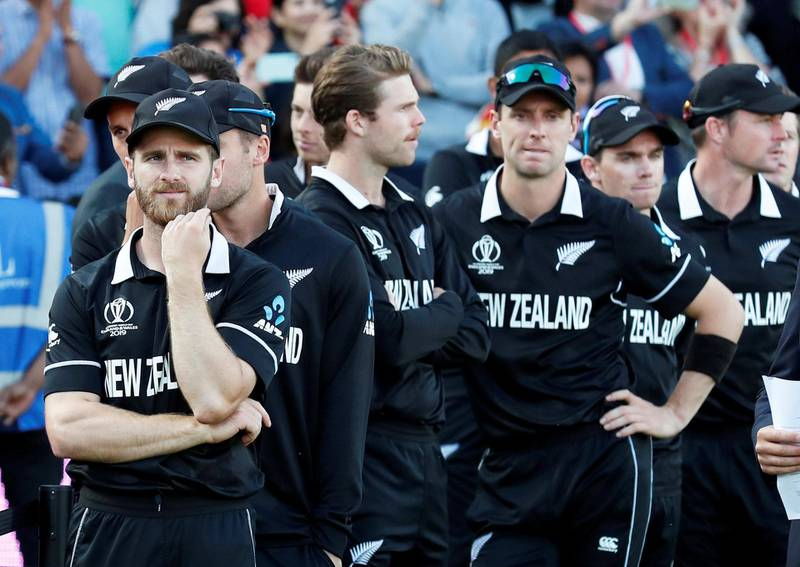 Cricket - ICC Cricket World Cup Final - New Zealand v England - Lord's, London, Britain - July 14, 2019   New Zealand's Kane Williamson and teammates looks dejected as they await their runners up medals   Action Images via Reuters/Peter Cziborra