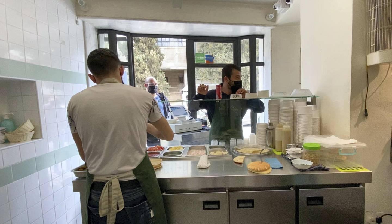Falafel sandwiches being prepared at Abu Mahjoub, in Jabal Al Weibdeh. Amy McConaghy / The National