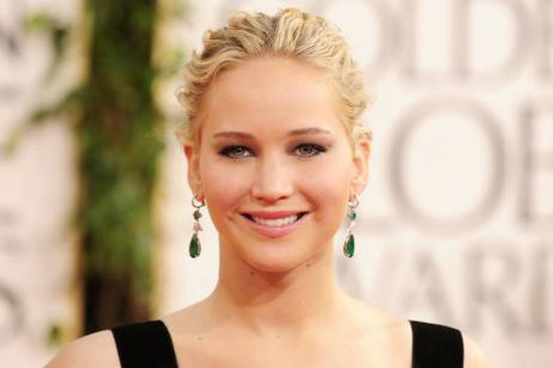 Actress Jennifer Lawrence arrives on the red carpet for the 68th annual Golden Globe awards at the Beverly Hilton Hotel in Beverly Hills, California January 16, 2011.  AFP PHOTO  / Robyn Beck