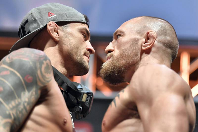 ABU DHABI, UNITED ARAB EMIRATES - JANUARY 22: (L-R) Opponents Dustin Poirier and Conor McGregor of Ireland face off during the UFC 257 weigh-in at Etihad Arena on UFC Fight Island on January 22, 2021 in Abu Dhabi, United Arab Emirates. (Photo by Chris Unger/Zuffa LLC)