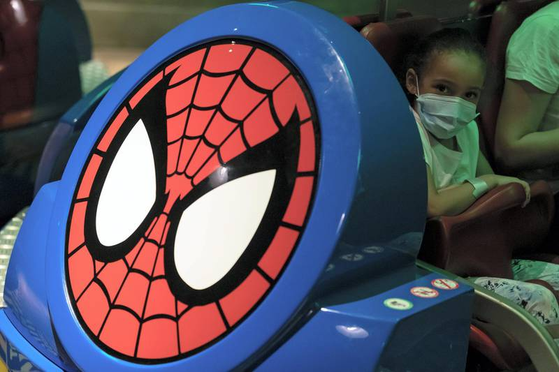 Dubai, United Arab Emirates - Reporter: N/A. Covid-19/Coronavirus. A young girl rides the Spiderman ride. IMG World of Adventure opened on recently to the public with strict Covid-19/Coronavirus safety measures. Tuesday, July 21st, 2020. Dubai. Chris Whiteoak / The National