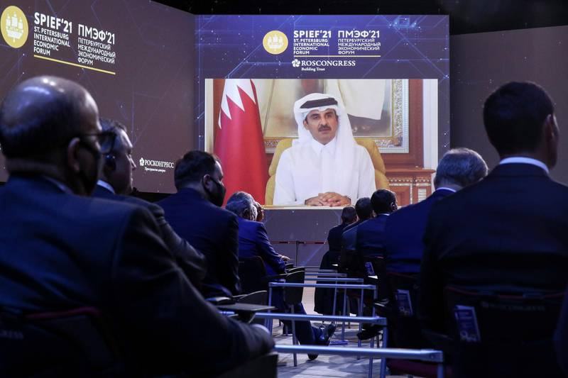 Qatar's Emir Sheikh Tamim bin Hamad Al Thani appears via video link at the St. Petersburg International Economic Forum in St. Petersburg, Russia, Friday, June 4, 2021. Russian President Vladimir Putin on Friday praised his country's response to the COVID-19 pandemic and called for a stronger global response to global warming as he sought to bolster Russia's international standing. (TASS Host Photo Agency Pool via AP)