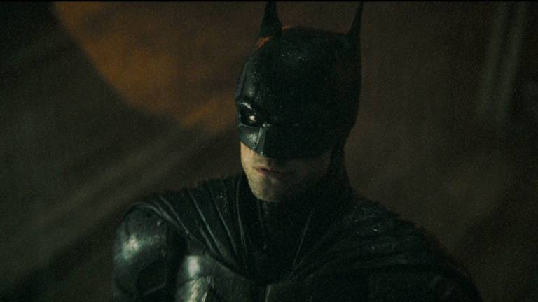 An image that illustrates this article 'The Batman' trailer shows Robert Pattinson as a dark and violent superhero
