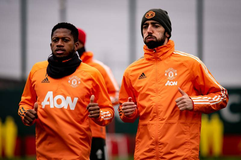 MANCHESTER, ENGLAND - MARCH 16: (EXCLUSIVE COVERAGE) Fred and Bruno Fernandes of Manchester United in action during a first team training session at Aon Training Complex on March 16, 2021 in Manchester, England. (Photo by Ash Donelon/Manchester United via Getty Images)