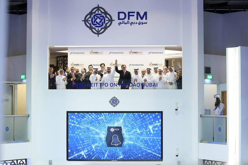 DUBAI , UNITED ARAB EMIRATES – March 23 , 2017 : Tariq Bin Hendi , Director of ENBD REIT ( center left ) and  Shayne Nelson , group Executive Officer of Emirates NBD ( center right ) during the bell ringing of ENBD REIT's listing on Nasdaq Dubai held at Dubai Financial Market in Dubai. ( Pawan Singh / The National ) For Business. Story by Lucy Barnard. ID No - 15960 *** Local Caption ***  PS2303- ENBD REIT03.jpg