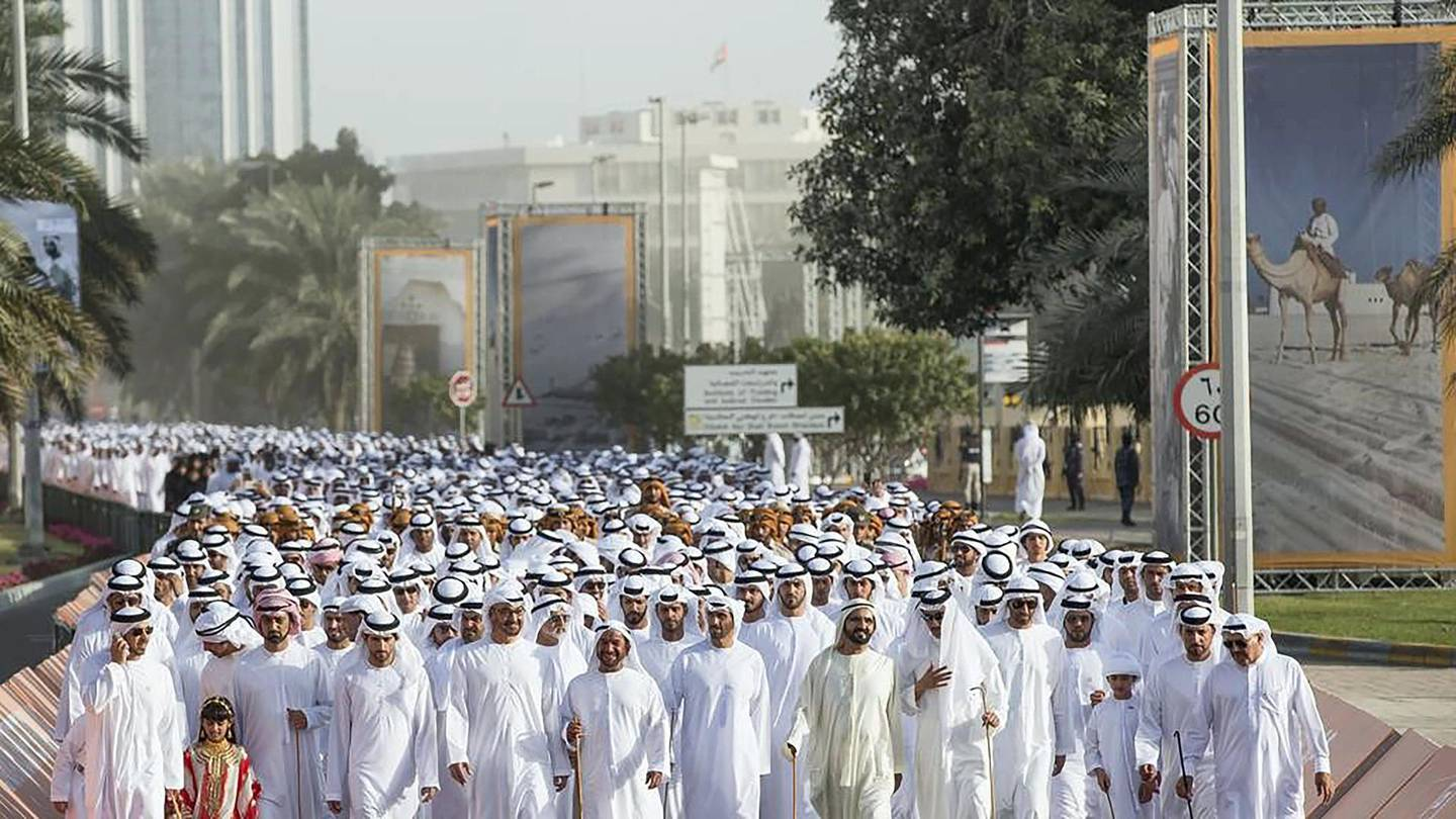 Sheikh Mohammed bin Rashid, Vice President and Ruler of Dubai, and Sheikh Mohammed bin Zayed, Crown Prince of Abu Dhabi and Deputy Supreme Commander of the Armed Forces, are joined by other sheikhs and dignitaries on the march from Al Manhal Palace to Qasr Al Hosn. Ryan Carter / Crown Prince Court ������� Abu Dhabi