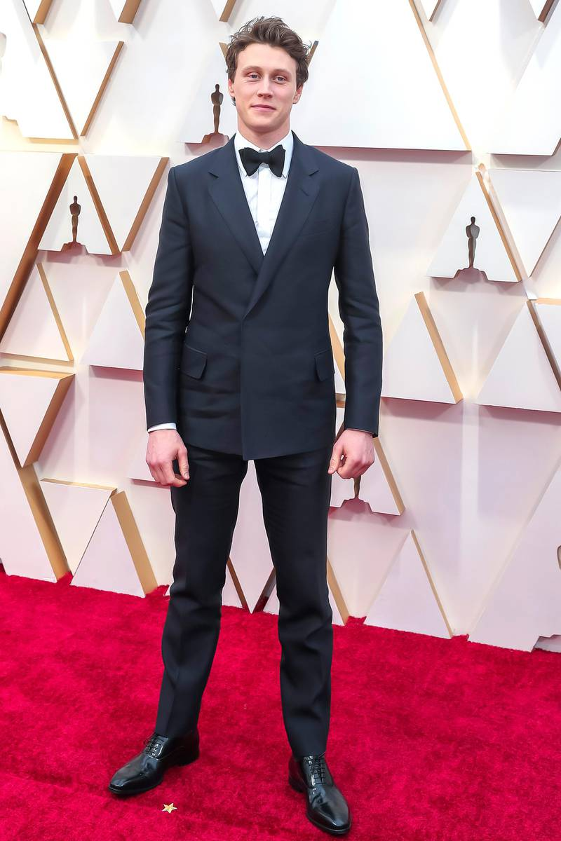 epa08206711 George MacKay arrives during the 92nd annual Academy Awards ceremony at the Dolby Theatre in Hollywood, California, USA, 09 February 2020. The Oscars are presented for outstanding individual or collective efforts in filmmaking in 24 categories.  EPA-EFE/DAVID SWANSON