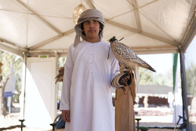 ABU DHABI, UNITED ARAB EMIRATES - DEC 6, 2017Falconers from 90 countries attend the fourth International Festival of Falconry. This gathering is a tribute to a similar meeting 41 years ago, in 1976, when the UAE Founding Father Sheikh Zayed invited falconers from around the world to convene in the desert of Abu Dhabi and build a strategy for the sport's development.(Photo by Reem Mohammed/The National)Reporter: Anna ZachariasSection: NA