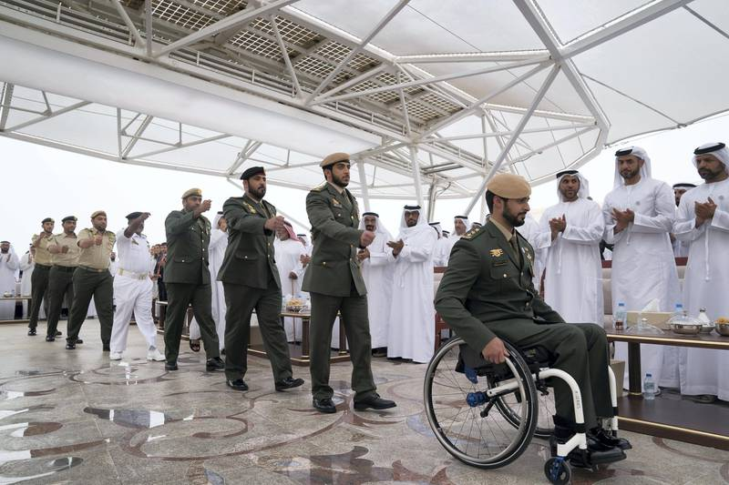 ABU DHABI, UNITED ARAB EMIRATES - April 23, 2018:  HH Sheikh Zayed bin Hamdan bin Zayed Al Nahyan (R) and members of the UAE Armed Forces who served in Yemen, participate in a medal ceremony during a Sea Palace barza.  ( Mohamed Al Hammadi / Crown Prince Court - Abu Dhabi ) ---