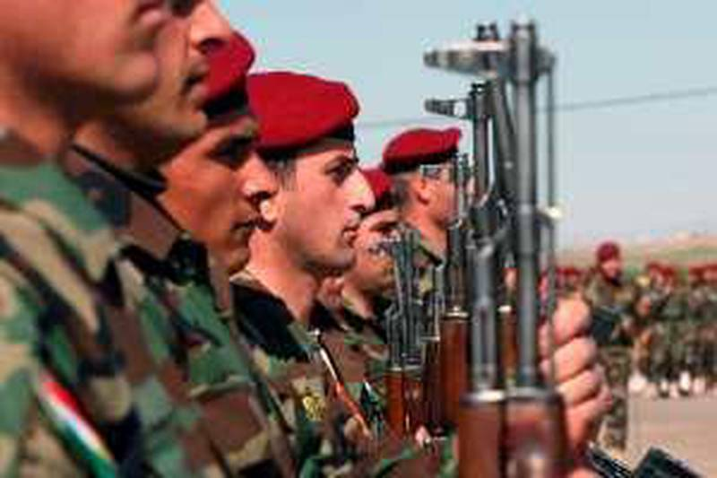 Kurdish Peshmerga soldiers stand at attention during their graduation ceremony in the northern Kurdish city of Arbil on March 2, 2010. 1,200 peshmerga soldiers graduated during the ceremony. Thousands of peshmerga fighters will cast their votes for the parliamentary elections on March 4, three days ahead of the scheduled Iraqi general election on March 7. AFP PHOTO/SAFIN HAMED *** Local Caption ***  995082-01-08.jpg
