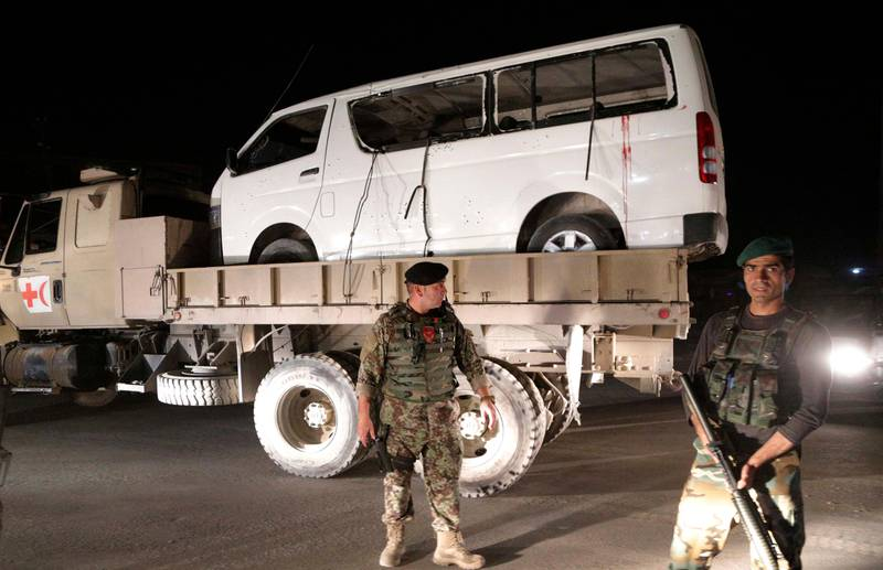 epa06280656 Afghan security officials remove a damaged vehicle after a suicide bomb attack that targeted Marshal Fahim military academy in Kabul, Afghanistan, 21 October 2017. At least 15 Afghan military cadets were killed and four were injured in the attack claimed by Taliban militants. The bombing came a day after two suicide attacks at Afghan mosques left at least 80 people dead.  EPA/HEDAYATULLAH AMID