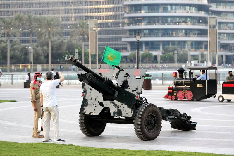 Dubai Police fire the Eid Al Fitr cannon to mark end of Ramadan at the Burj Khalifa, Dubai on May 12th, 2021. Chris Whiteoak / The National.  Reporter: N/A for News