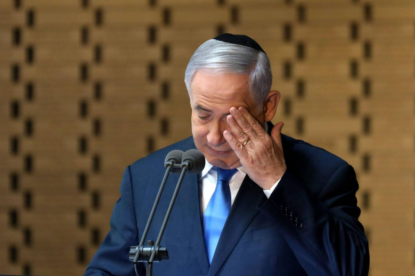 Israeli Prime Minister Benjamin Netanyahu delivers a speech at the state memorial ceremony for the fallen soldiers of the 1973 Yom Kippur War, at the Hall of Remembrance on Mt. Herzl in Jerusalem on October 10, 2019. / AFP / GALI TIBBON