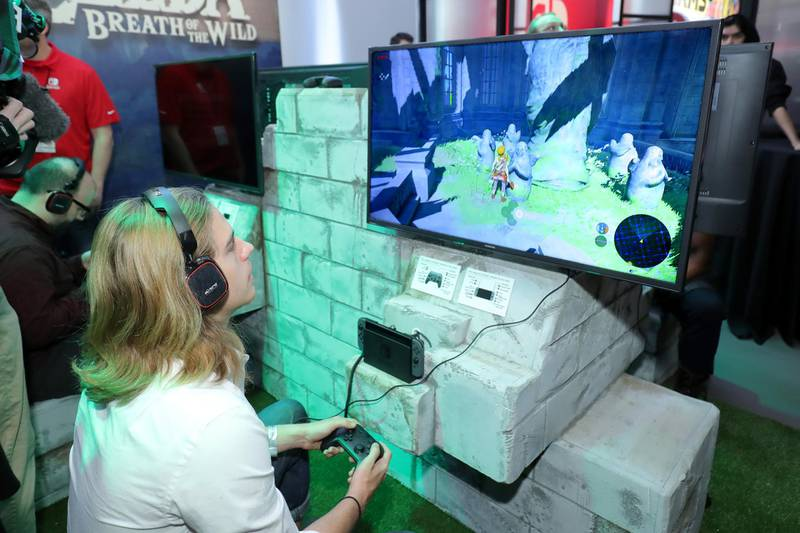 NEW YORK, NY - JANUARY 13: In this photo provided by Nintendo of America, A guest enjoys playing The Legend of Zelda: Breath of the Wild on the groundbreaking new Nintendo Switch at a special preview event in New York on Jan. 13, 2017. Launching in March 3, 2017, Nintendo Switch combines the power of a home console with the mobility of a handheld. It's a new era in gaming that delivers entirely new ways to play wherever and whenever people want.   Neilson Barnard/Getty Images for Nintendo of America/AFP