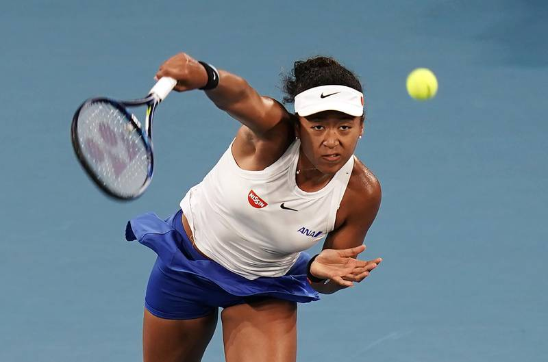 epa08113883 Naomi Osaka of Japan serves during her second round match against Sofia Kenin of the USA on Day 4 of the Brisbane International tennis tournament at the Queensland Tennis Centre in Brisbane, Queensland, Australia, 09 January 2020.  EPA/DAVE HUNT AUSTRALIA AND NEW ZEALAND OUT