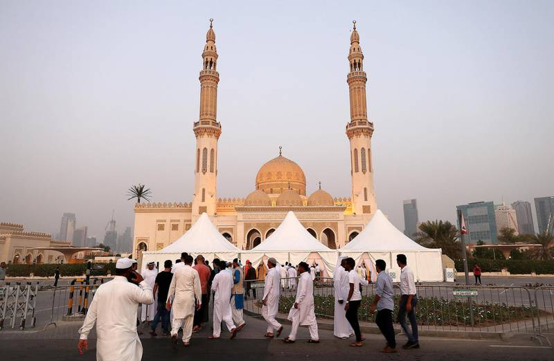 DUBAI, UNITED ARAB EMIRATES, August 21 – 2018 :- People going to Zabeel mosque for the Eid Al Adha prayers in Dubai. ( Pawan Singh / The National )  For News. Story by Nawal