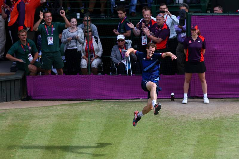 LONDON, ENGLAND - AUGUST 05:  Andy Murray of Great Britain celebrates after defeating Roger Federer of Switzerland in the Men's Singles Tennis Gold Medal Match on Day 9 of the London 2012 Olympic Games at the All England Lawn Tennis and Croquet Club on August 5, 2012 in London, England. Murray defeated Federer in the gold medal match in straight sets 2-6, 1-6, 4-6.  (Photo by Julian Finney/Getty Images)