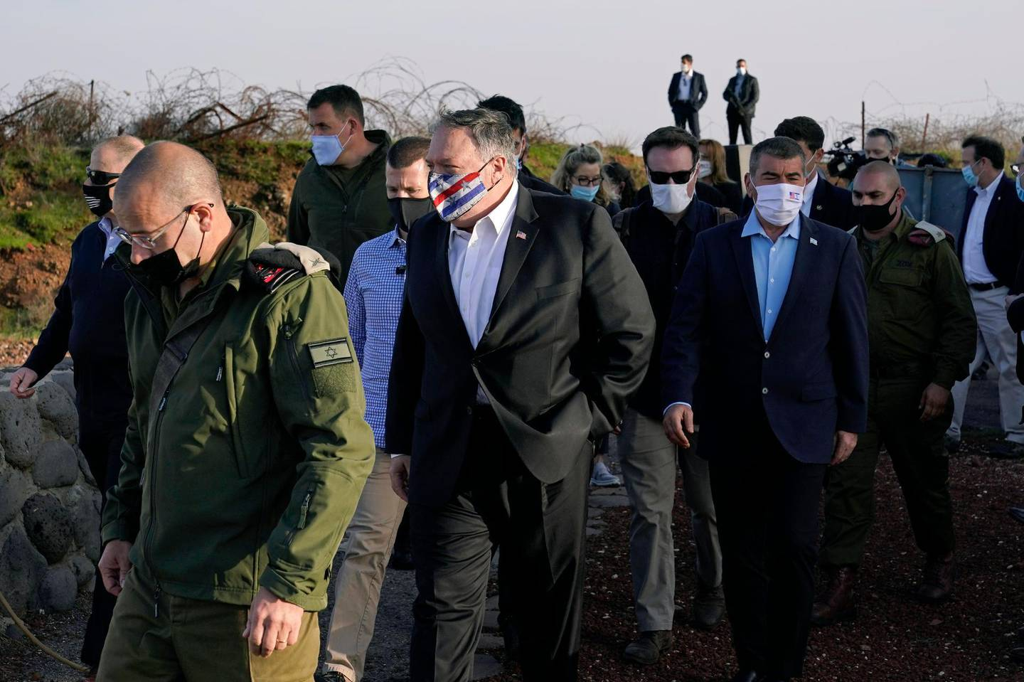 Secretary of State Mike Pompeo, center, arrives for a security briefing on Mount Bental in the Israeli-controlled Golan Heights, near the Israeli-Syrian border, Thursday, Nov. 19, 2020. (AP Photo/Patrick Semansky, Pool)