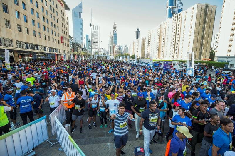 Dubai, United Arab Emirates - Participants after their run at the Dubai 30x30 Run at Sheikh Zayed Road.  Leslie Pableo for The National