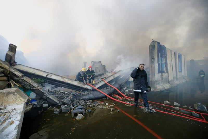 FILE PHOTO: Firefighters inspect after a fire at a storage site in Baghdad, housing the boxes from Iraq's May parliamentary election, Iraq June 10, 2018. REUTERS/Thaier Al-Sudani /File Photo