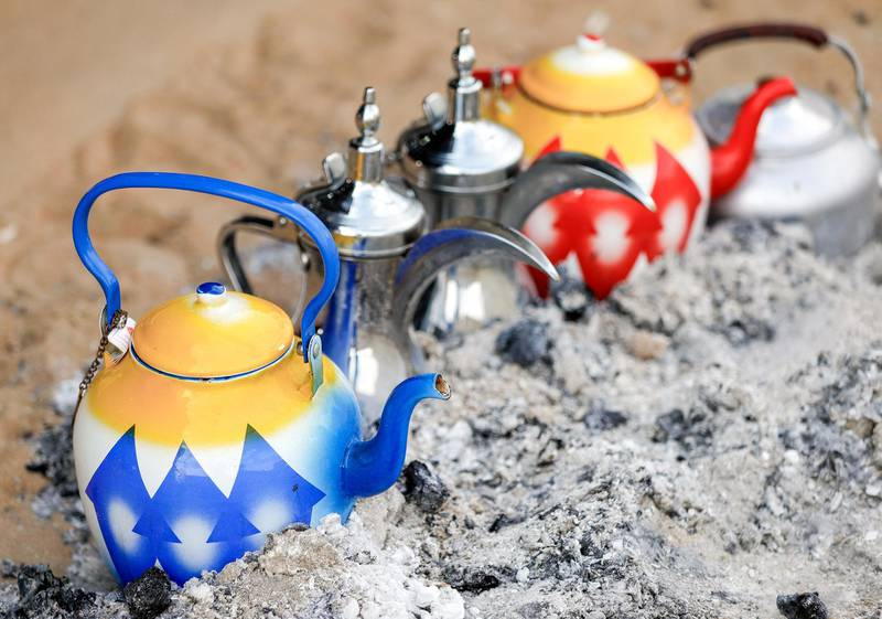 Abu Dhabi, United Arab Emirates, December 10, 2019.    Al Dhafra Festival 2019.--  Tea pots heating up on charcoal in a tent.Victor Besa/The NationalSection:  NAReporter:  Anna Zacharias