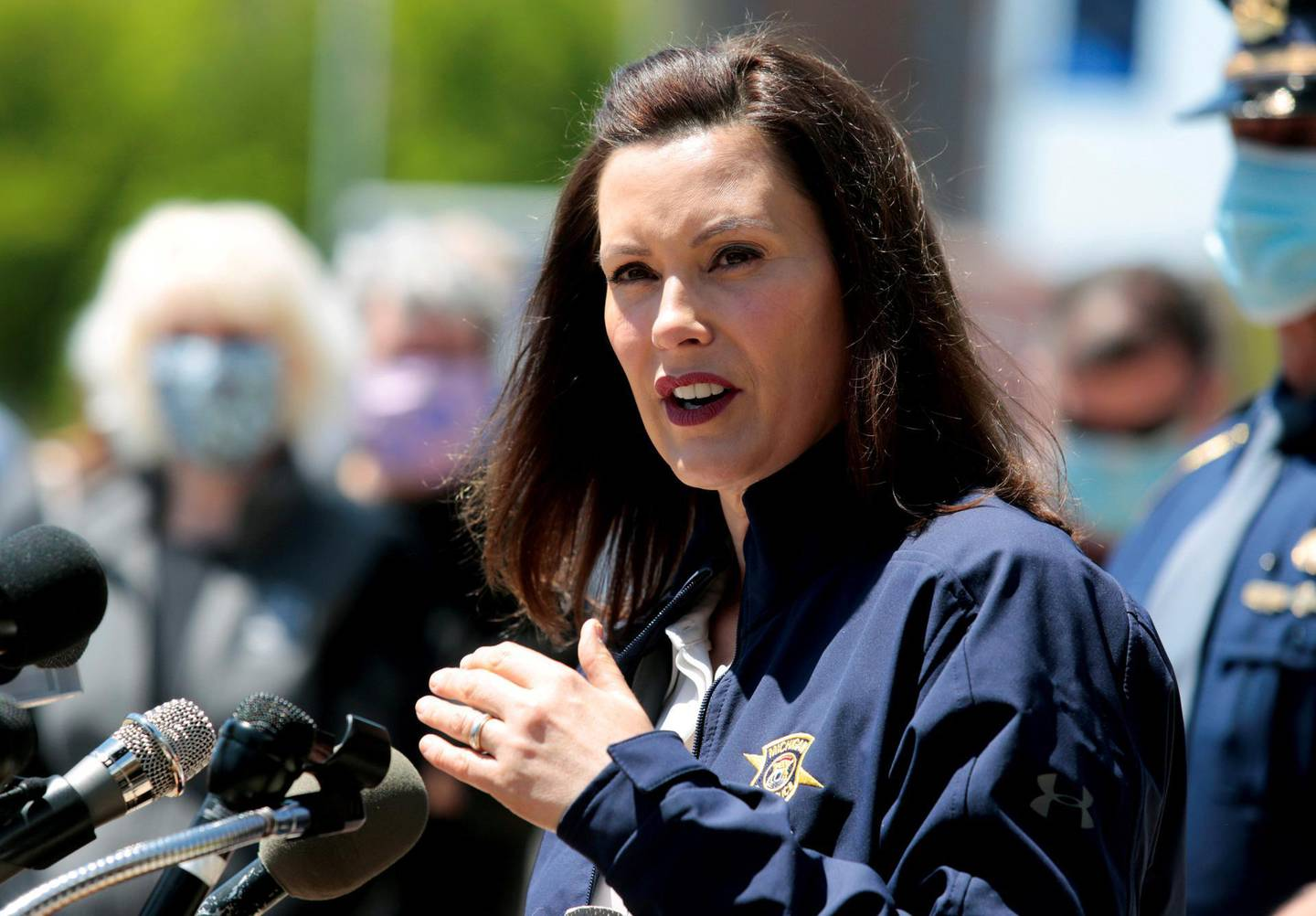 FILE PHOTO: Michigan Governor Gretchen Whitmer addresses the media about the flooding along the Tittabawassee River, after several dams breached, in downtown Midland, Michigan, U.S., May 20, 2020. REUTERS/Rebecca Cook/File Photo