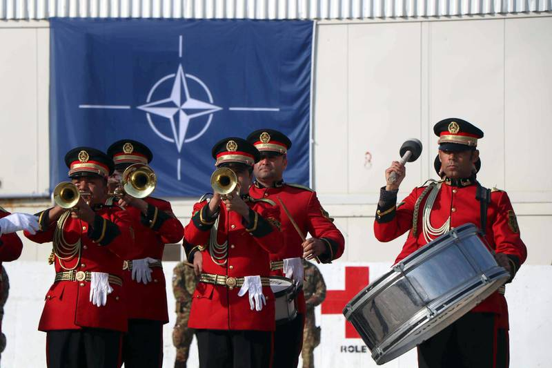 epa08062754 A band performs as Italian soldiers of NATO Resolute Support Mission attend a change of regional command ceremony in Herat, Afghanistan, 11 December 2019. Italian Brigadier General Enrico Bardvani took over the command for the next six months.  EPA/JALIL REZAYEE