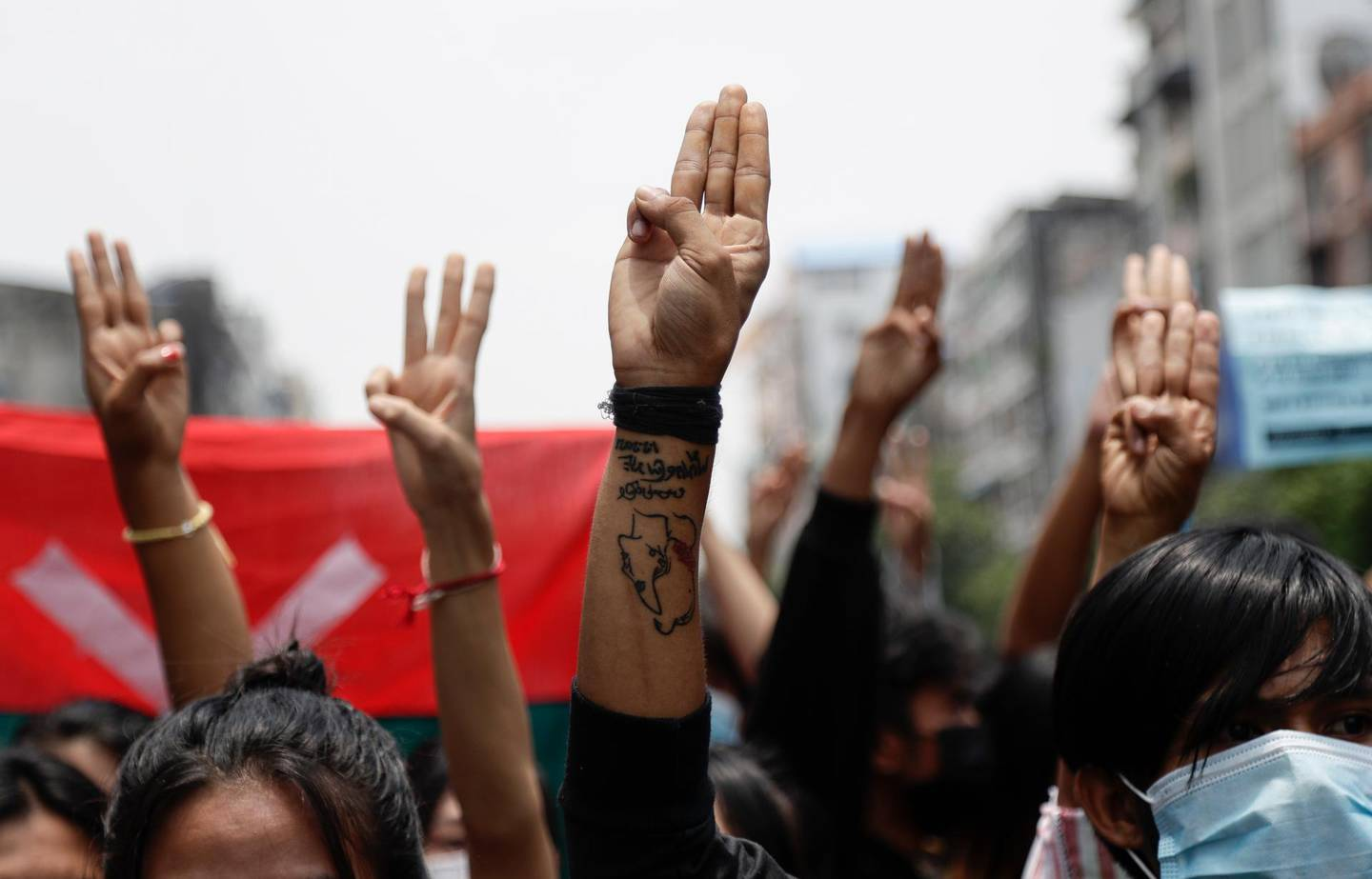 epa09161194 Demonstrators flash three-fingers salutes as they march  during an anti-military coup protest in Yangon, Myanmar, 26 April 2021. Myanmar activists have criticized the agreement between the junta leader and Association of Southeast Asian Nations (ASEAN) leaders after an emergency summit and have vowed to continue protests.  EPA/STRINGER