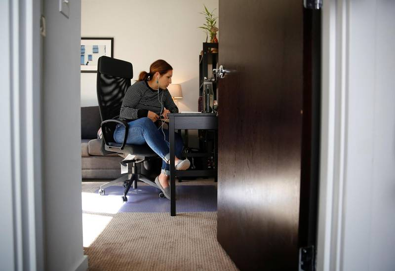 Seattle City Councilmember Teresa Mosqueda attends a council meeting by phone in her office due to the council's temporary work from home policy during the coronavirus disease (COVID-19) outbreak in Seattle, Washington, U.S. March 23, 2020. REUTERS/Lindsey Wasson