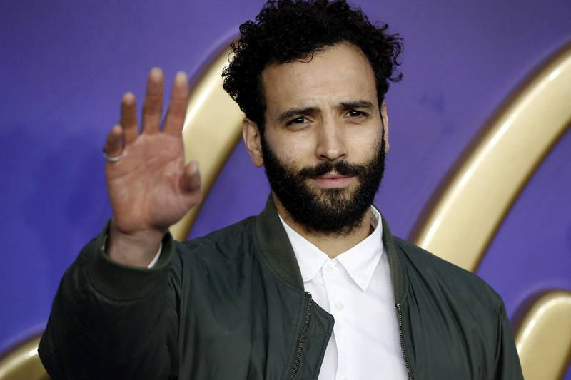Dutch actor Marwan Kenzari poses on arrival for the European Gala of Aladdin in central London on May 9, 2019. (Photo by Tolga AKMEN / AFP)