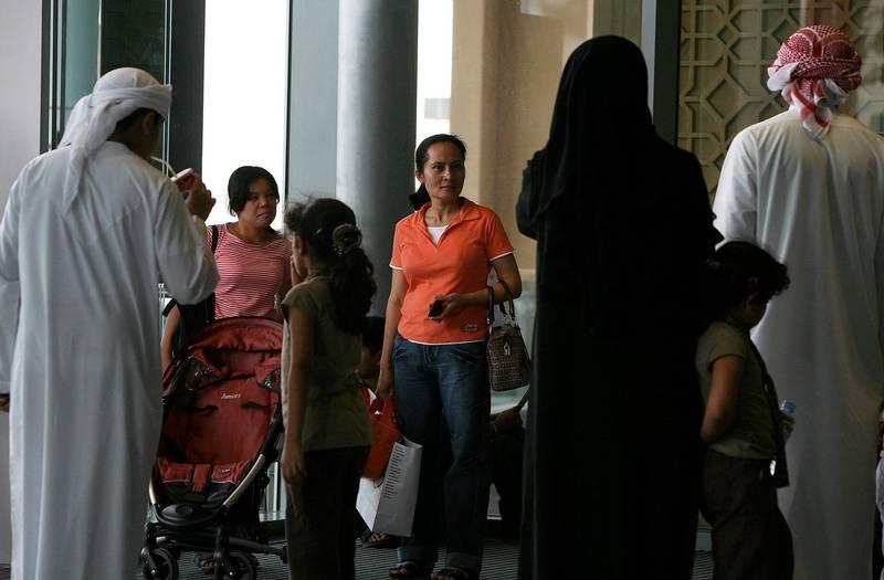 DUBAI, UNITED ARAB EMIRATES Ð June 30: House maids with one of the family at Dubai Mall in Dubai. (Pawan Singh / The National) *** Local Caption ***  PS05- MAID.jpg