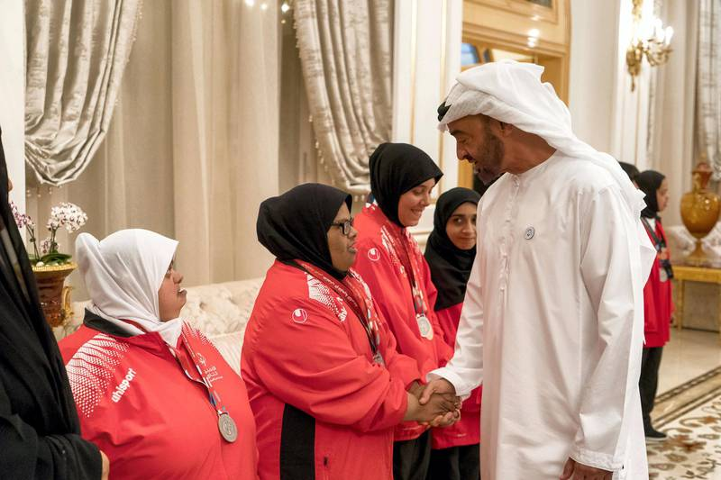 ABU DHABI, UNITED ARAB EMIRATES - April 09, 2018: HH Sheikh Mohamed bin Zayed Al Nahyan, Crown Prince of Abu Dhabi and Deputy Supreme Commander of the UAE Armed Forces (R), receives members of the UAE Special Olympics team, during a Sea Palace barza.  ( Rashed Al Mansoori / Crown Prince Court - Abu Dhabi ) ---