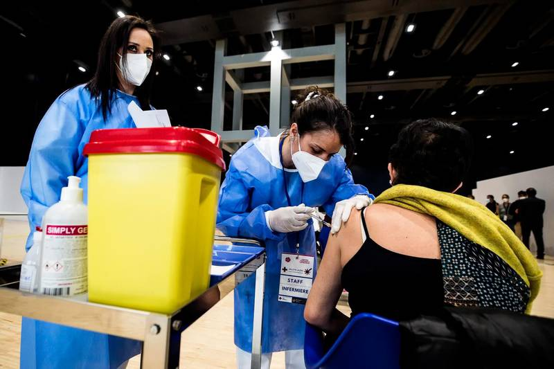 epa09034144 Health personnel carry out vaccination operations to school personnel during the inauguration of the new hub for vaccination against COVID-19, set up by the Local Health Company Asl Roma 2 at the 'La Nuvola' congress center, in Rome, Italy, 24 February 2021.  EPA/ANGELO CARCONI